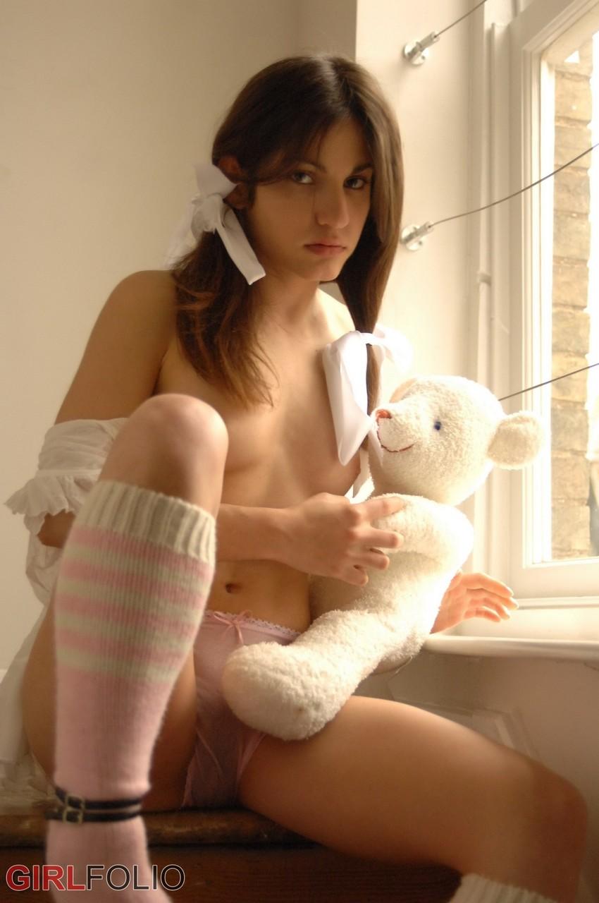 Ненасытная девушка на шпильках через трусики ласкает свою щёлочку